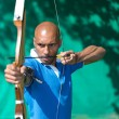 Archer at shooting range with bow and arrow — Stock Photo #65723265