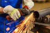 Worker cutting steel with angle grinder — Stock Photo