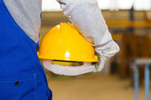 Closeup of a hardhat and construction laborer — Stock Photo