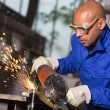 Worker grinding metal with angle gringer — Stock Photo #66517369