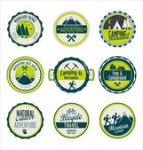 Set of outdoor adventure blue and green retro labels — Stock Vector