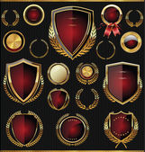 Golden shields, laurels and medals collection — Stock Vector
