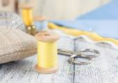 Set of reel of thread, needle and pins for sewing and needlework — Stock Photo