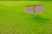 Sign in green grass  — Stock Photo