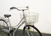 Vintage bicycle white background — Stock Photo
