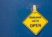 Open against a blue door — Stock Photo