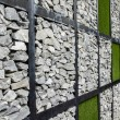 Wall of stone and artificial grass — Stock Photo #54052353
