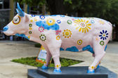 Artificial Cow with Colourful Painting Flowers — Stock Photo