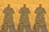Shadow of Three Photographer Man on Field — Stock Photo