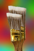 Two brushes against colored background — Stock Photo