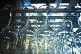 Upturned wine glasses in restaurant bar close-up — Stock Photo