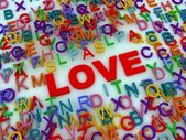 Red love word among letters — Stock Photo