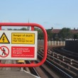 Electric shock hazard no entry or trespassing sign near rail or train station — Stock Photo #52628361