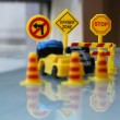 Car Accident zone cordoned off with a yellow stop sign post. two cars with a major collision with one car toppled by another brown car & area cordoned by yellow barricades — Stock Photo #52628437