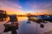 Single boats during sunrise — Foto Stock