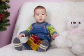 Little  boy  with present — Stock Photo