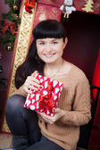 Woman holding a gift — Stock Photo