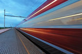 Train in railway at speed — Stock Photo
