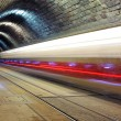 Train disappearing into a tunnel — Stock Photo #63792777