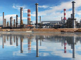 Petrochemical plant with reflection in water, Oil Industry — Zdjęcie stockowe