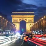 Arc de triomphe Paris city at sunset — Stock Photo #69692395