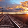 Orange sunset in low clouds over railroad — Stock Photo #69693059