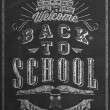 Welcome Back To School Typographical Background On Chalkboard — Stock Photo #56185543