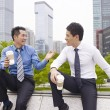 Asian business people talking outdoors — Stock Photo #52347663