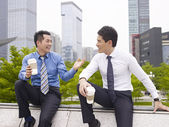 Asian business people talking outdoors — Stock Photo
