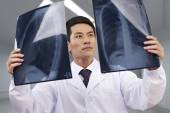 Asian doctor at work — Stockfoto