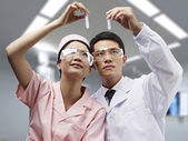 Asian medical professionals at work — Stock Photo