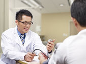 Asian doctor and patient — Stock Photo
