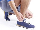 Tying up shoelace — Stock Photo