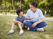 Asian father and son having a conversation — Stock Photo