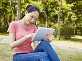 Young woman using tablet outdoors — Stock Photo