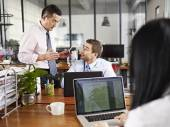 Multinational executives discussing business in office — Stock Photo