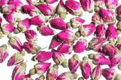 Background with dried rose buds — Stock Photo
