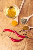 Overhead view of cooking ingredients, spices, herds and oil — Stock Photo