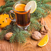 Mulled wine  with  spices and orange and walnuts — Stock Photo