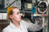 Scientist working in a liquid nitrogen bank — Stock Photo