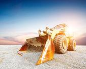 Big excavator on new construction site — Stock Photo