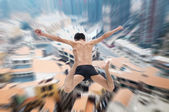 Man jumping with cityscape — Stock Photo