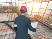 Architects looking housing project with building — Stock Photo