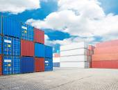 Stack of cargo containers at the docks — Stock Photo