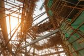 Silhouettes of scaffolding on sunset — Stock Photo
