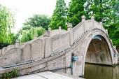 Old park bridge at spring — Stock Photo
