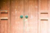 Classic wooden door with iron handle — Stock Photo