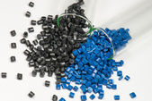 Blue and black polymer pellets — Stock Photo