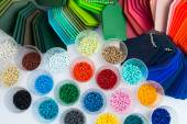 Several dyed plastic polymer granulates — Stock Photo