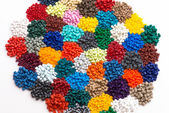 Heaps of dyed plastic granulate — Stock Photo